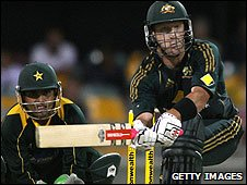 Kamran Akmal watches as Cameron White sweeps
