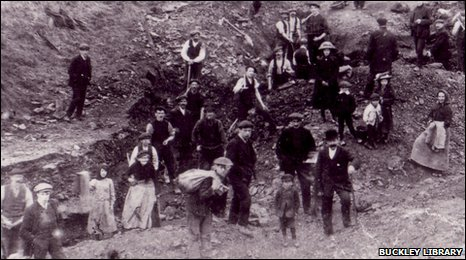 Familiies pick coal during a miners' strike, c1911-12