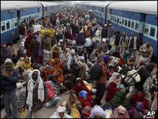 Pilgrims crowd the train station at Prayag in India