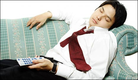 Sleeping man with remote