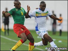 Cameroon's Geremi (L) challenges Roguy Meye of Gabon