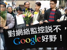 A group of Google users hold a banner to wish Google well in Hong Kong on January 14, 2010