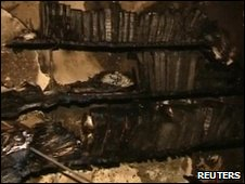 Burnt bookshelf in Etz Hayyim synagogue