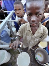 Child with cup in Haiti