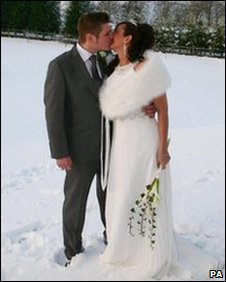 Couple getting married in the snow