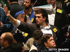 Traders work the floor of the New York Mercantile Exchange in New York City
