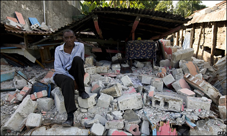 A Haitian man sits on the rubble that was his house in Jacmel (20 January 2010)