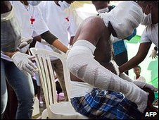 A man being treated in Cite Soleil, Haiti, 16 January 2010