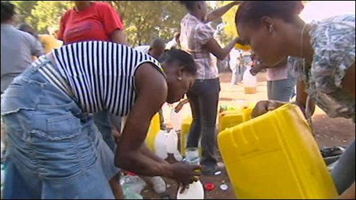 charity workers give out aid in Haiti
