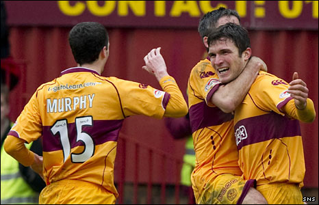 The Motherwell players celebrate a goal against St Mirren