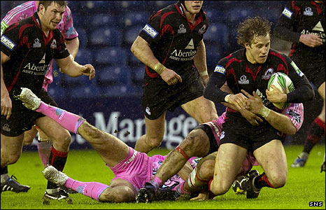 Mark Robertson (right) is halted by the Stade Francais back-line.