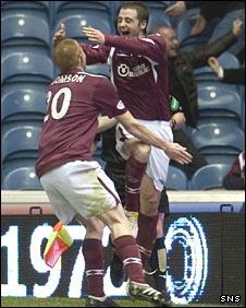 Jason Thompson congratulates Hearts team-mate Scott Robinson