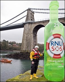 Green bottle being used in RNLI fund-raising appeal