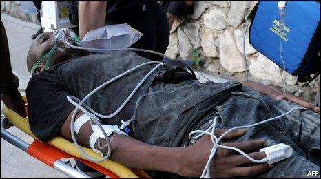 Survivor Wismond Exantus Jean Pierre is taken to a French field hospital in Port-au-Prince, Jan 23