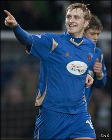 Liam Craig celebrates after scoring his penalty