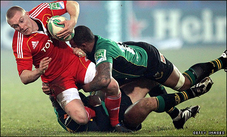 Munster's Keith Earls is tackled in Friday's match
