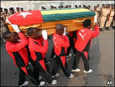 Togo players carry the coffin of deputy national coach Abalo Amelete