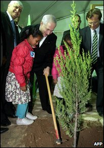 Israeli Prime Minister Benjamin Netanyahu joins Jewish settlers in planting a tree during a ceremony marking the Jewish Arbor Day in the settlement of Maale Adumim in the occupied West Bank, on the outskirts of Jerusalem, on January 24, 2010