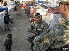 US troops patrol makeshift camp
