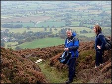 Derek Brockway is given a tour of Moel Famau by Erin Robinson