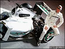 Michael Schumacher poses with Mercedes's Silver Arrow F1 livery on a 2009 Brawn