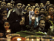 Egyptians at a candlelight vigil in Cairo to protest against the killings of Copts in Naga Hamady - 20 Jan 2010