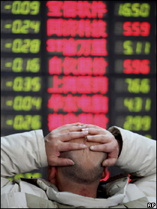 Market trader with his hands on his head (Image: AP)