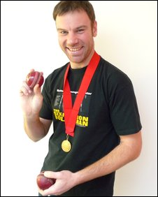BBC Leicester's Charles Dagnall with his cricket balls and medal