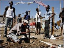 Homeless Haitians build shelters