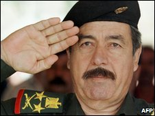 Majid salutes before unveiling a statue of Saddam, Baghdad, May 1999