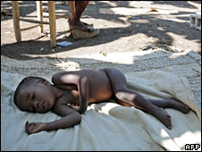 A baby sleeps on temporary bedding at a destroyed Christian orphanage in Leogane. Photo: 23 January 2010