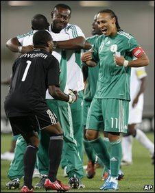Vincent Enyeama and Peter Odemwingie celebrate Nigeria's penalty  win