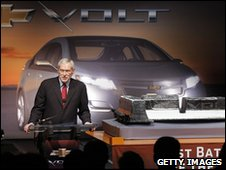 GM chairman Ed Whitacre with the battery pack for the Chevrolet Volt electric vehicle