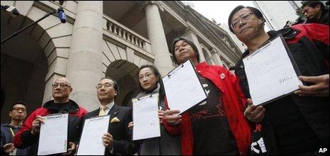 Five Hong Kong legislators, from left, Albert Chan, Alan Leong, Tanya Chan, Leung Kwok-hung and Wong Yuk-man hold their resignation letters