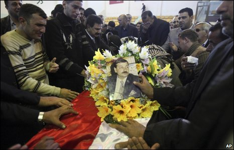 Mourners at the funeral of Monthir Ali Shnawa, a former Iraqi national basketball team player, in Baghdad, 26 January