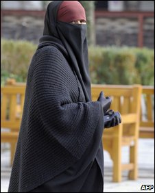 A woman wears a full-length veil in Lyon, 25 January 
