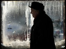 A man seen in front of a frosty window in Bucharest, Romania, 22 January, 2010