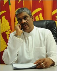 "Sarath Fonseka, the main opposition challenger in Sri Lanka""s presidential election, talks on the phone at his office in Colombo on January 26, 2010"