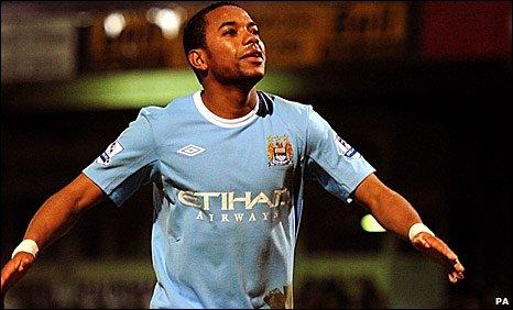 Robinho celebrates scoring for Manchester City against Scunthorpe