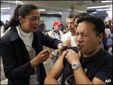 A Mexican man is vaccinated against swine flu at a subway station in Mexico City.