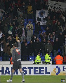 Owen Coyle salutes the Burnley fans