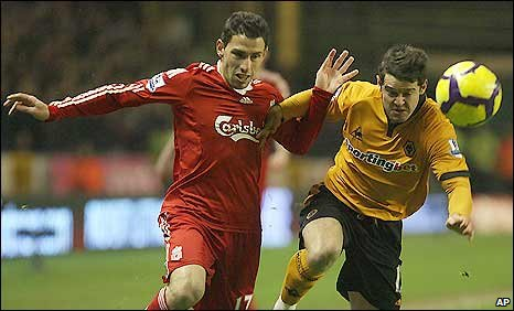 Liverpool's Maxi Rodriguez (left) battles with Wolves winger Matt Jarvis