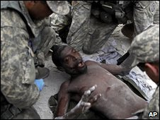 Rico Dibrivell is checked by US soldiers after being rescued