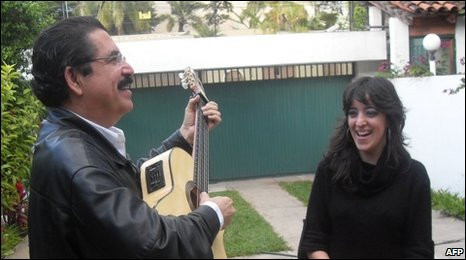 Manuel Zelaya sings to his daughter Hortensia in the courtyard of the Brazilian embassy on 14 January J