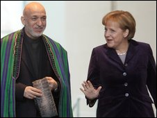Afghan President Hamid Karzai and German Chancellor Angela Merkel in Berlin - 27 January 2010 