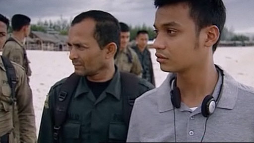 Men and police in Lampuuk, Indonesia