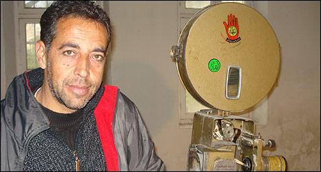 Ismail Khatib by projector in Cinema Jenin