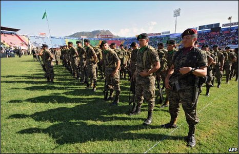 Soldiers attend the inauguration of Honduran President-elect Porfirio Lobo at the Tiburcio Carias Andino stadium in Tegucigalpa