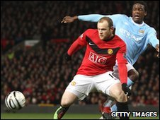 Dedryck Boyata of Manchester City competes for the ball with Wayne Rooney