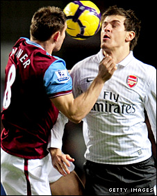 Aston Villa's James Milner and Arsenal's Aaron Ramsey